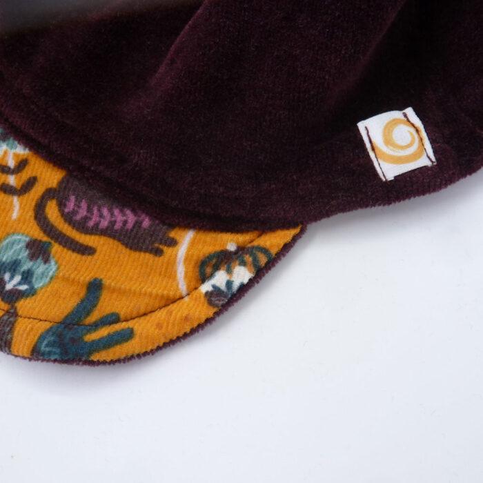 Biuwaa Pur Mütze mit Schirm Detail